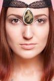 Elven flicka med prydnader på henne framsida Fotografering för Bildbyråer