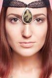 Elven flicka med prydnader på henne framsida Royaltyfria Bilder