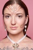 Elven girl with drawings on her face. Elven girl with ethnic drawings on her face royalty free stock photo