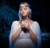 Elven girl at night forest Royalty Free Stock Photos