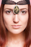 Elven girl with ornaments on her face stock image