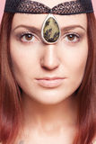 Elven girl with ornaments on her face royalty free stock images