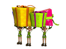 Elves Carrying Large Presents Royalty Free Stock Photography