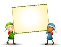 Elves Carrying Xmas Sign Royalty Free Stock Image