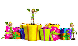 Elves With Christmas Gifts. Lots of Elves with some very large presents Stock Photos