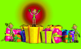 Elves With Christmas Gifts. Lots of Elves with some very large presents Royalty Free Stock Photography