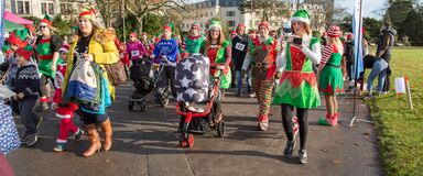 Elves in Christmas parade Royalty Free Stock Images