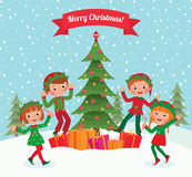 Elves and Christmas tree. Cartoon elves having fun at Christmas party Royalty Free Stock Photography