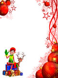 Elves on gift near big christmas red balls Royalty Free Stock Photo