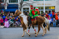 Elves on Horses in Holiday Parade Royalty Free Stock Image