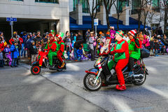 Elves Riding Scooters in Holiday Parade Royalty Free Stock Images