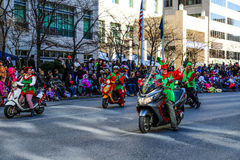 Elves Riding Scooters in Parade