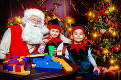 Elves with Santa stock images