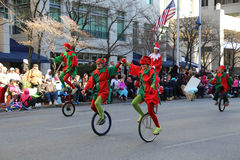Elves on Unicycles in Parade. Harrisburg, PA - November 21, 2015: Elves on unicycles on the downtown street in the City of Harrisburg during the annual Holiday Royalty Free Stock Photos