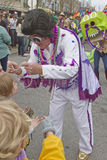 Elvis Character Bestows Mardi Gras Beads Stock Photo