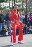 Elvis impersonator entertaining the crowd at the annual holiday Parade,Glens Falls,New York,2014 Stock Photo