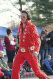 Elvis impersonator working his way through the Annual Holiday Parade,Glens Falls,New York,2014. Elvis impersonator working his way through the crowd during the stock images