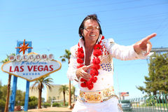 Elvis look-alike impersonator and Las Vegas sign Royalty Free Stock Photos