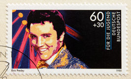 Elvis Presley. GERMANY - CIRCA 1988. A postage stamp printed in Germany shows image portrait of famous American singer Elvis Presley (1935-1977), circa 1988 Royalty Free Stock Photo