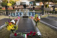 Elvis Presley grave at Graceland in Memphis, Tennessee. MARCH 22, 2019 - MEMPHIS, TENNESSEE, USA:   Elvis Presley`s grave in the Meditation Garden at Graceland royalty free stock image