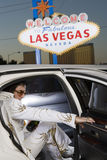 Elvis Presley Impersonator Stepping Out From Car. With 'Welcome To Las Vegas' sign in the background Royalty Free Stock Photo