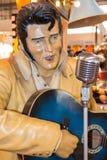 Elvis Presley Plastic statue with blue guitar an silver micropho. Ne, sculpture, figure stock image