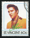 Elvis Presley. ST. VINCENT - CIRCA 1985: stamp printed by St. Vincent, shows Elvis Presley, American Entertainer, circa 1985 Royalty Free Stock Images