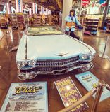 Elvis Presley statue and vintage Cadillac in a souvenir store in. Los Angeles, CA, USA - November 02, 2017: Elvis Presley statue and vintage Cadillac in a royalty free stock images