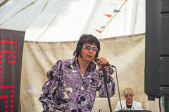 Elvis re-enactment at Levisham. Musical weekend on North York Moors Railway on 22nd July 2017 with an Elvis look alike was singing to a large audience in a tent stock images