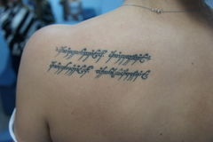 The Elvish inscription on the back of the girl Stock Image