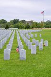 A small American flag honors the gravesite of a World War II veterans. Royalty Free Stock Images