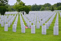 A small American flag honors the gravesite of a World War II veterans. Stock Photo