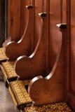 ELY, CAMBRIDGESHIRE/UK - NOVEMBER 24 : Wooden seats and cushions Royalty Free Stock Photos