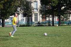 Elysian fields. Amateur football guys on the lawn. France, Paris - 24 September 2017: Elysian fields. Amateur football guys on the lawn, sports game royalty free stock images