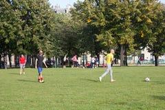 Elysian fields. Amateur football guys on the lawn. France, Paris - 24 September 2017: Elysian fields. Amateur football guys on the lawn, sports game stock photo