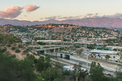 Elysian Valley and San Gabriel Mountains at sunset. The view from Elysian Park of the Los Angeles River, Elysian Valley, 110 freeway and the San Gabriel stock images