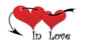 Em corações do amor. Foto de Stock
