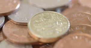 Em torno da moeda britânica video estoque