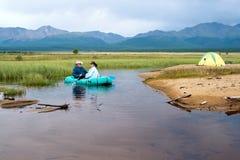 Em um barco inflável Imagens de Stock Royalty Free