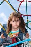 Em um campo de jogos das crianças Imagem de Stock Royalty Free