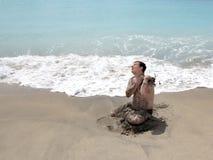 Em uma praia Fotos de Stock Royalty Free