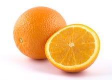 Em volta de e laranja cortada Fotografia de Stock