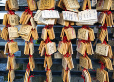 Ema plaques. Japanese people write their wishes such as happiness on wooden tablet and hang it on the stand inside the temple Royalty Free Stock Photos