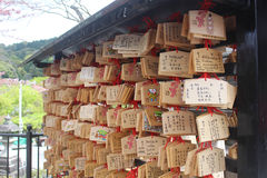 Ema plaques at Kiyomizu-dera temple in Kyoto. KYOTO, JAPAN - APRIL 11, 2016: On April 11, 2016. Japanese people write their wishes on the Ema and hang it on the Stock Photography