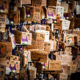 Prayer plaques in Japan. Tokyo, Japan - January 12 2015: Shinto worshipers write their prayers and wishes on wooden plaques known as 'Ema'. They can Stock Image
