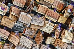 Ema wishes. TOKYO, JAPAN - APRIL 12, 2012: Ema, traditional wooden prayer boards in front of Ueno Toshogu Shrine in Taito ward of Tokyo. Kami (the spirits of stock images