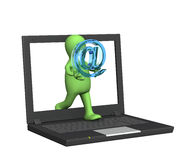 Email. 3d puppet a symbol email and laptop Royalty Free Stock Images