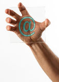 Email address at symbol on glass in hand Royalty Free Stock Images