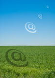 Email alias. Above green field above green field royalty free illustration