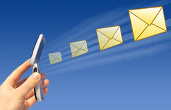 Email being sent by a wireless. Conceptual image of email  being sent by a hand held mobile device Royalty Free Stock Photos